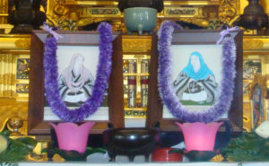 framed images of Kakushinni, left, and Eshinni, right, before the altar at Hawaii Betsuin