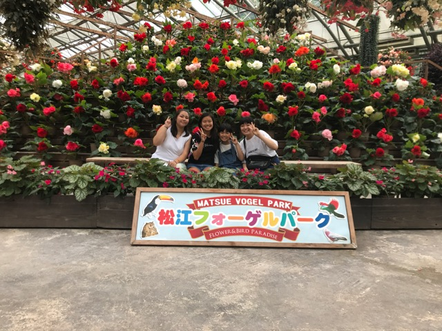 four girls in front of roses at Matsue Vogel Park
