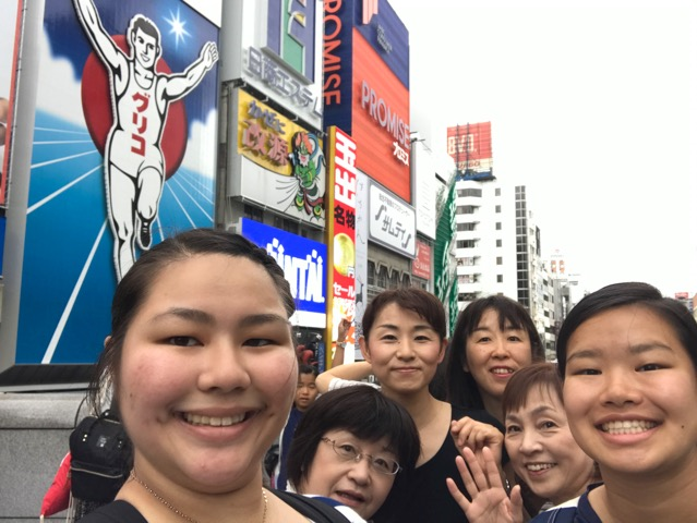 group photo in Tokyo with lighted billboards
